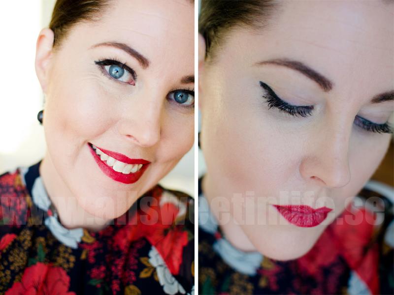 makeup med röda läppar och grafisk eyeliner